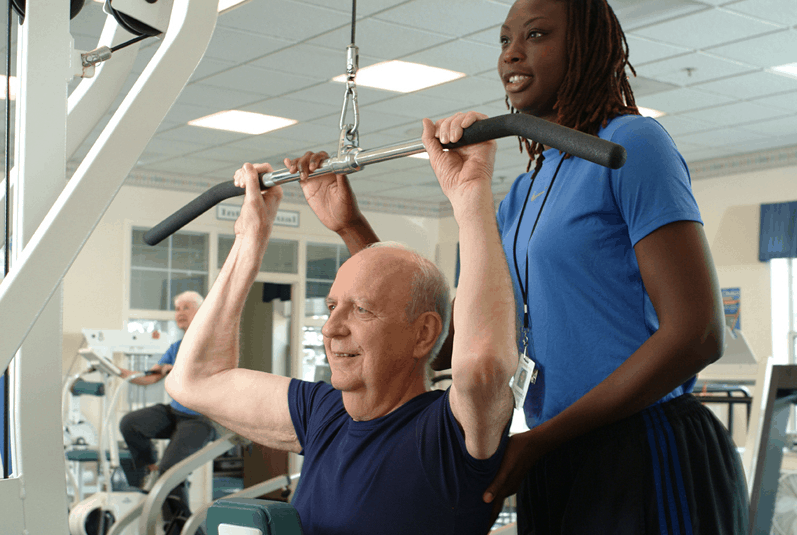 resident with personal trainer