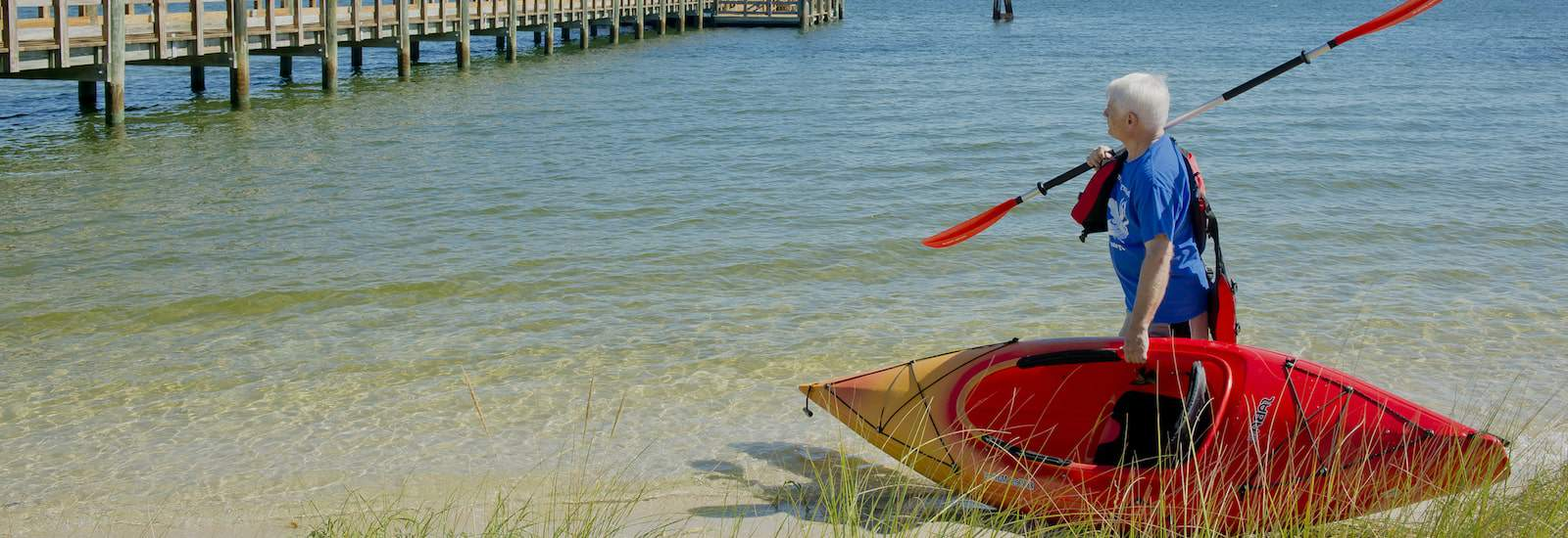 resident with a kayak along the water