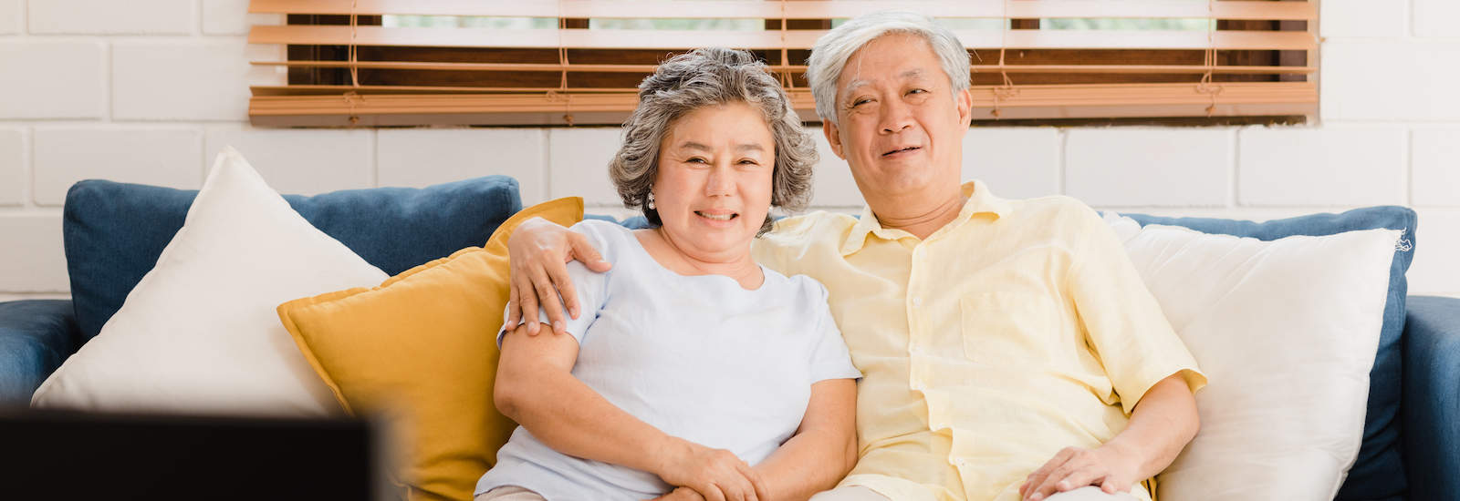 Asian elderly couple sitting