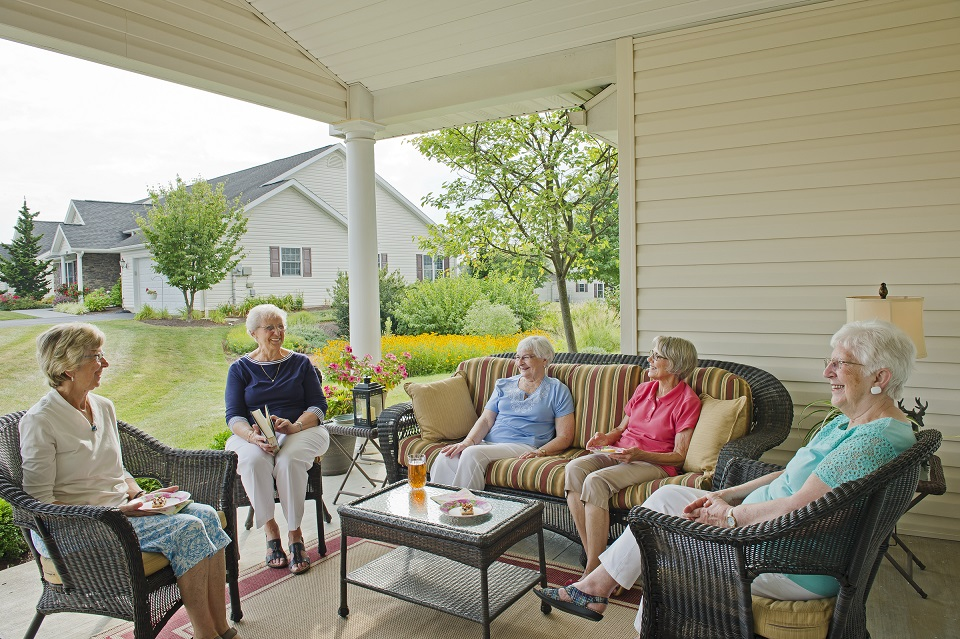 residents sitting on porch