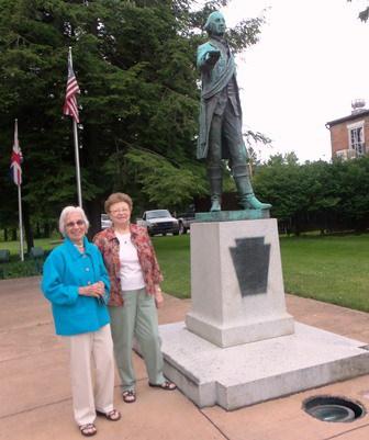 seniors at statue