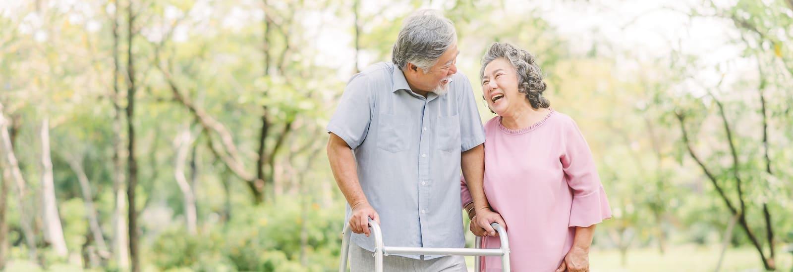 Happy loving Asian senior couple talking a walk