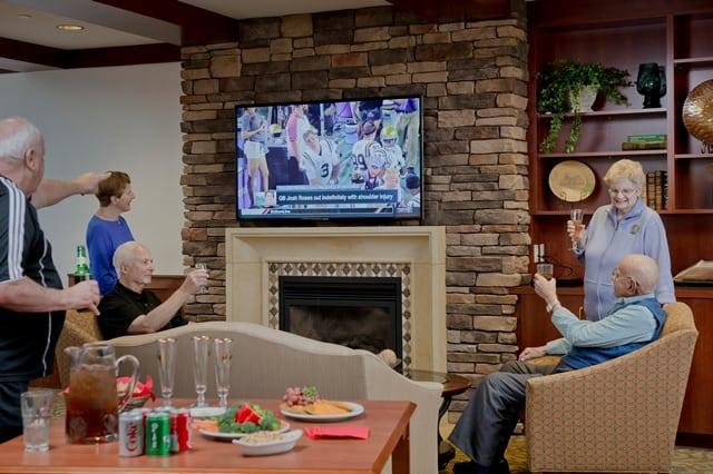 seniors watching football