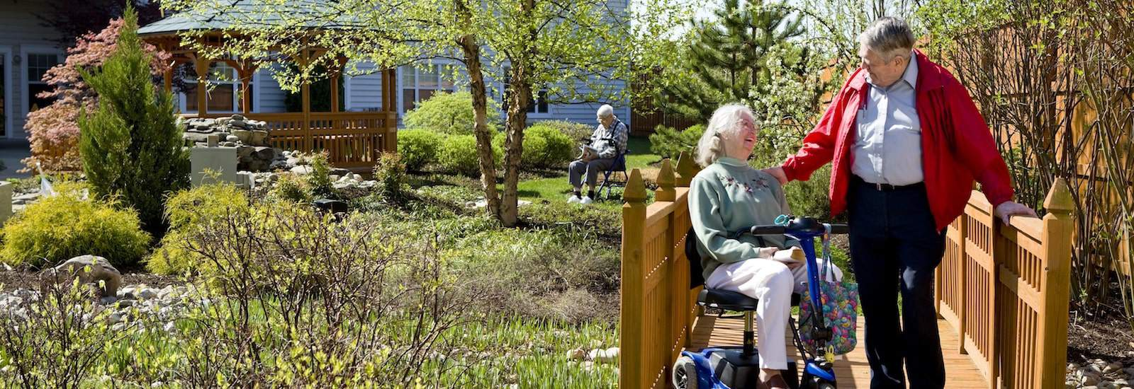 senior with mobile aid in assisted living