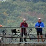 cyclists on bridge