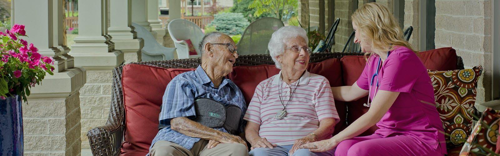 seniors chatting with nurse