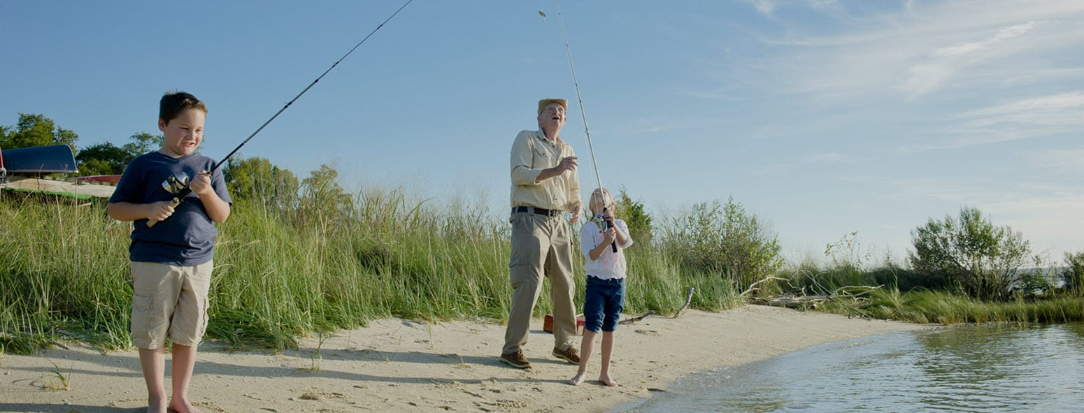senior fishing with grandson