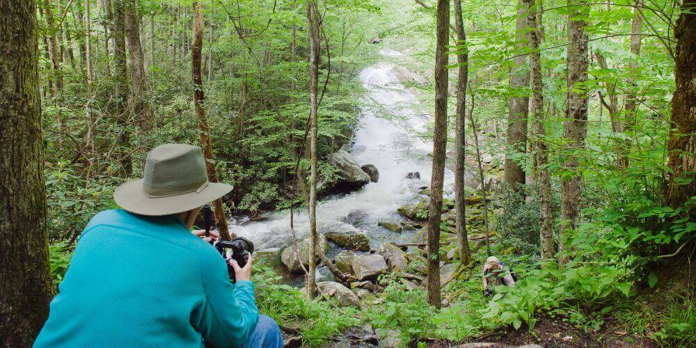 resident photographing the creek on the trails at maryville