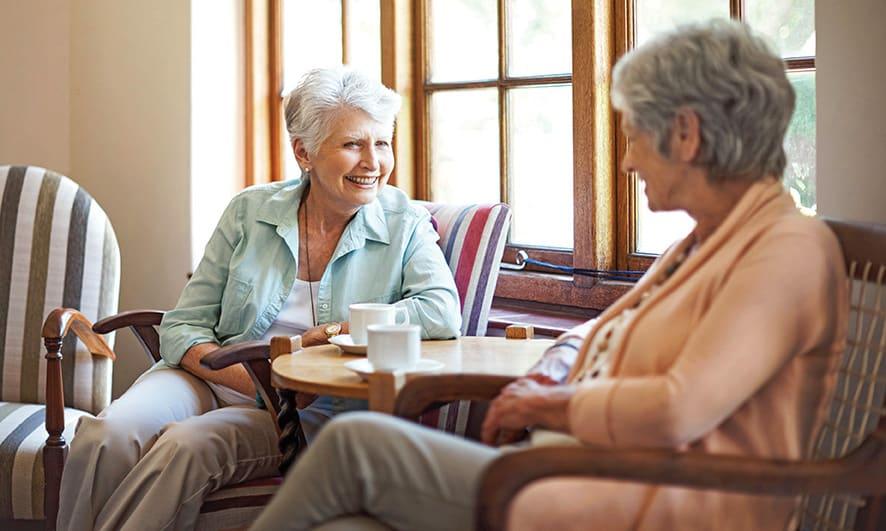 seniors chatting over coffee