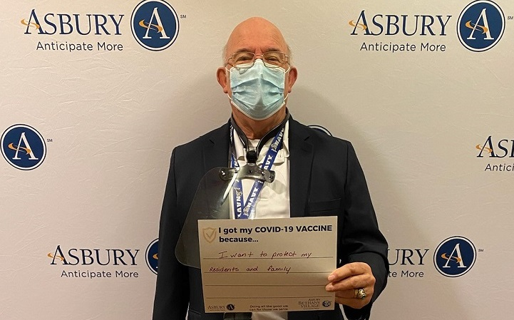 senior living healthcare worker receives COVID-19 vaccine at Asbury