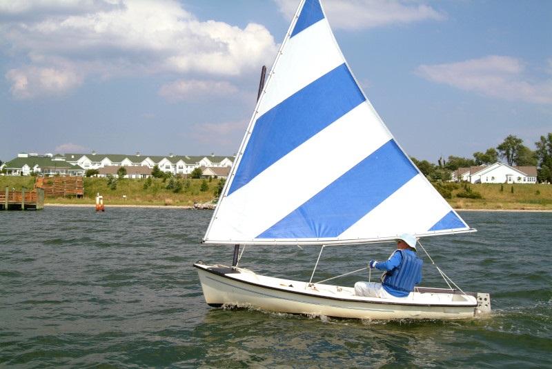 senior sailing on a lake near Asbury Solomons