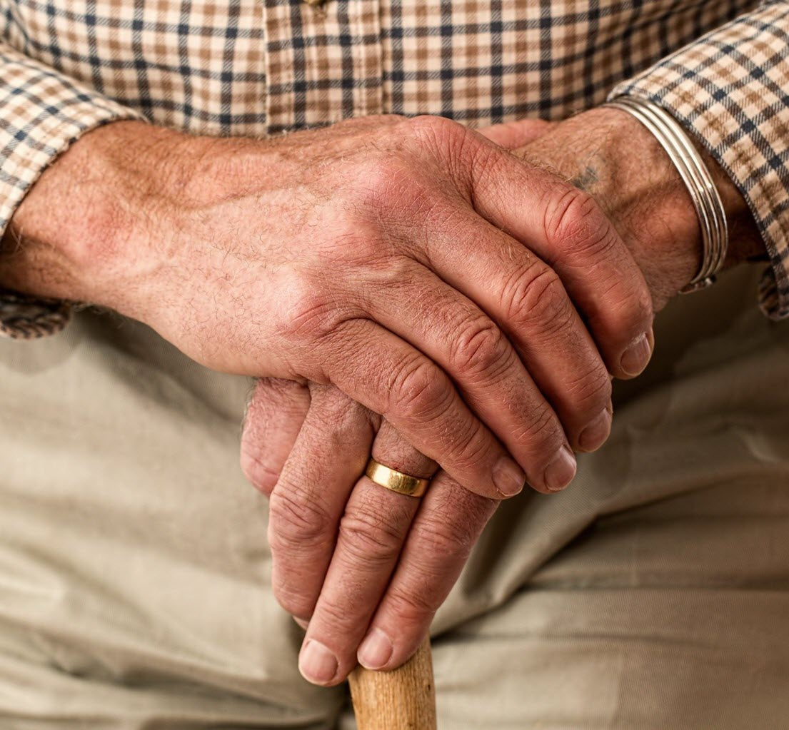 senior with his hands overlapped getting help from a loved one