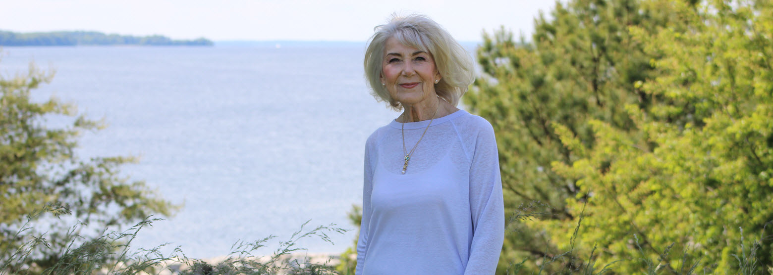 senior woman outside with Patuxent river in the background