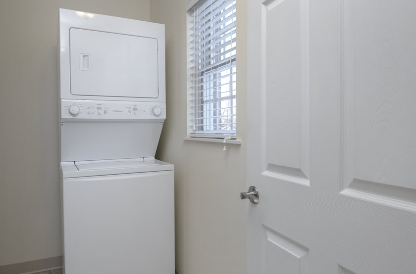washer and dryer inside a cottage