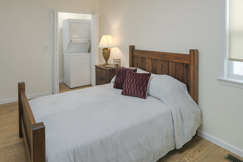 bedroom inside a senior apartment at Asbury RiverWoods