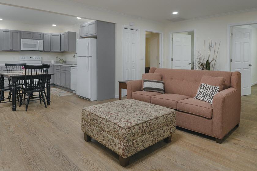 living room inside a senior living apartment at Asbury RiverWoods