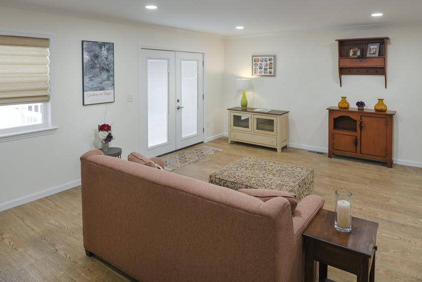 living room inside a senior apartment at Asbury RiverWoods