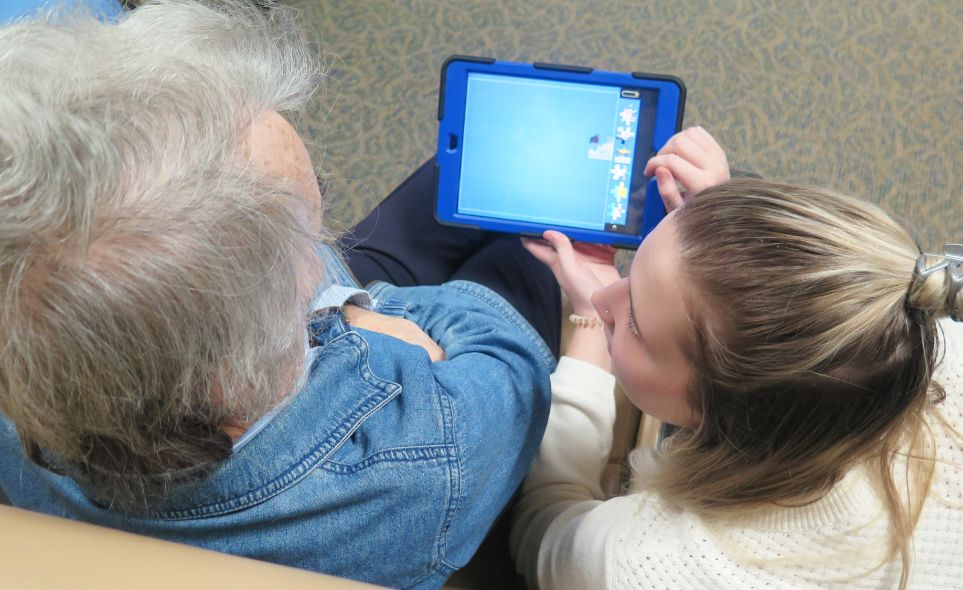 RiverWoods receives grant to purchase iPad for Memory Care Residents