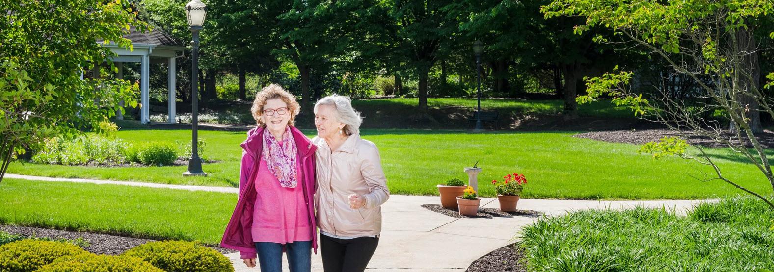 residents enjoying a walk around riverwoods campus
