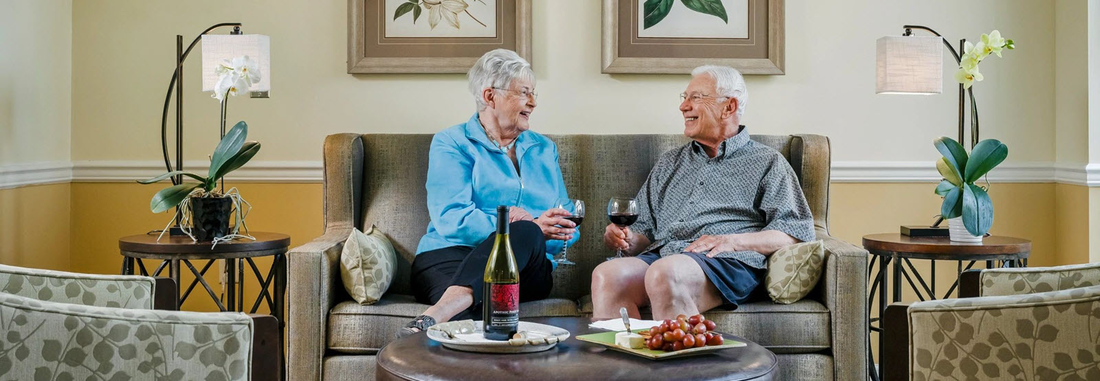 resident couple enjoying wine on the couch