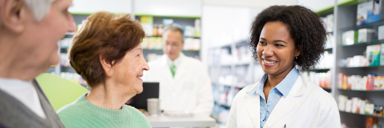 Senior couple talking at pharmacy