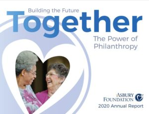 annual report cover of two female Asbury residents sharing a laugh