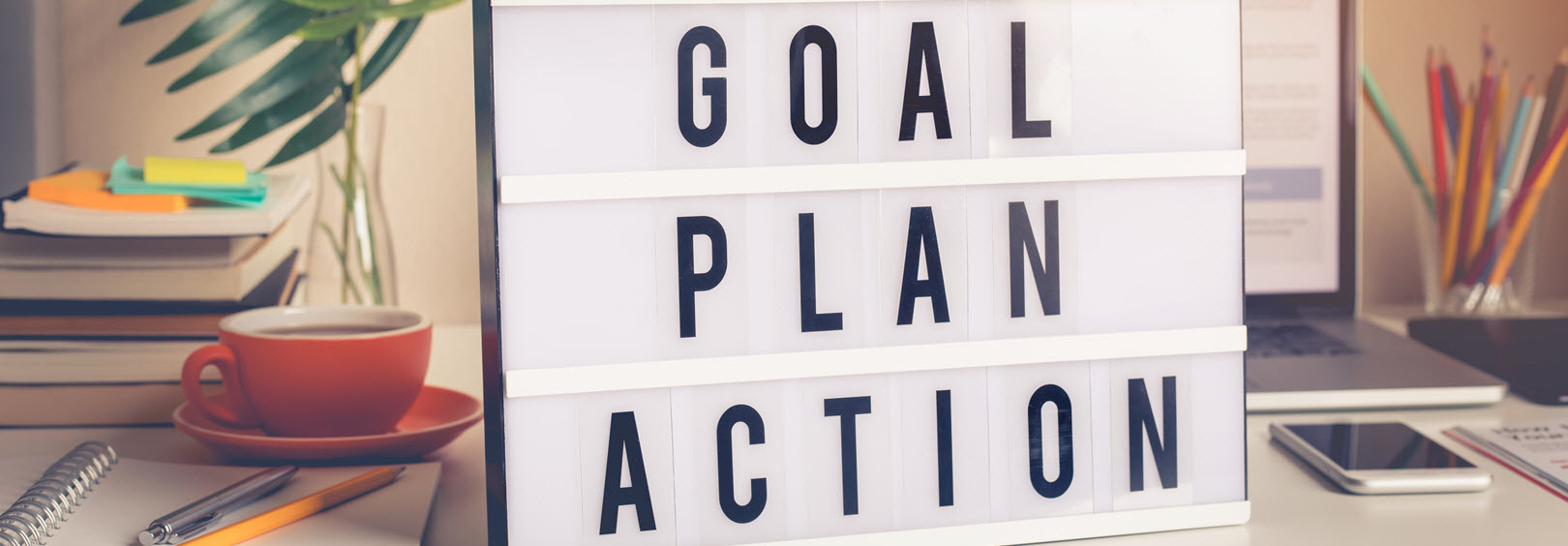 sign displaying the words goal plan and action